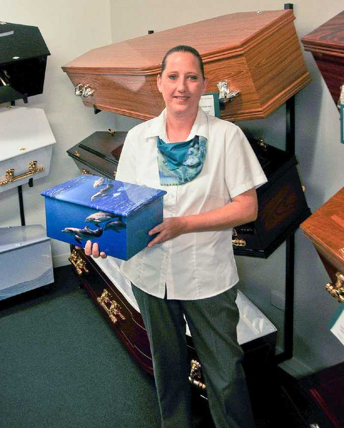 PROFESSIONAL: Cilla O'Hare shows off a fancy casket at Gladstone Valley Funerals.