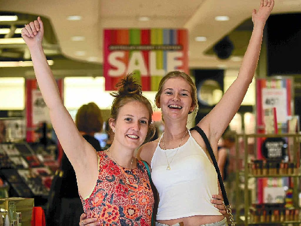 BARGAIN HUNT: Sisters Olivia Scruton (top left) and Daisy Whitehead join the crowd at the Myer Sunshine Plaza Boxing Day stocktake sale.