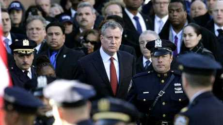 New York City Mayor Bill de Blasio (C) exits the funeral of New York Police Officer Rafael Ramos at Christ Tabernacle Church in Glendale, New York, USA, 27 December 2014. Ramos and Officer Wenjian Liu were gunned down last weekend while sitting in their patrol car in Brooklyn.