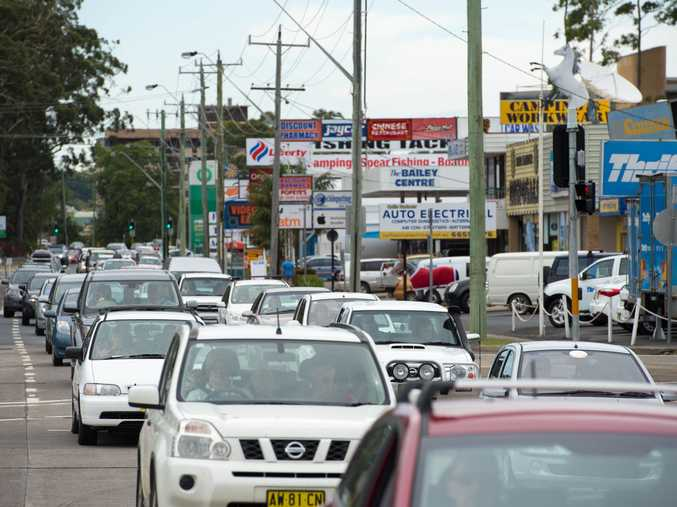 Steady rain and high traffic volumes is making it a crawl through Coffs Harbour central.