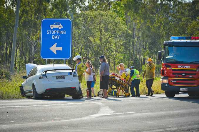 One man with spinal injuries was taken to hospital in an ambulance while concerned owners were still in shock after a two vehicle accident on the Gladstone Benaraby Rd yesterday afternoon. Photo Mike Richards / The Observer