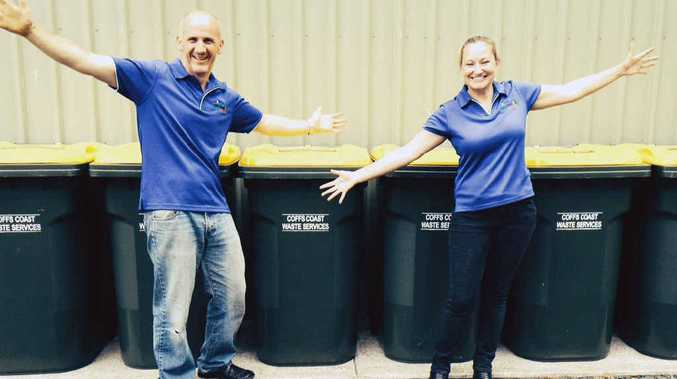 BIN-TASTIC: CCWS Assessors Mike Symons and Lia Purves, surrounded by 360-litre recycling bins.
