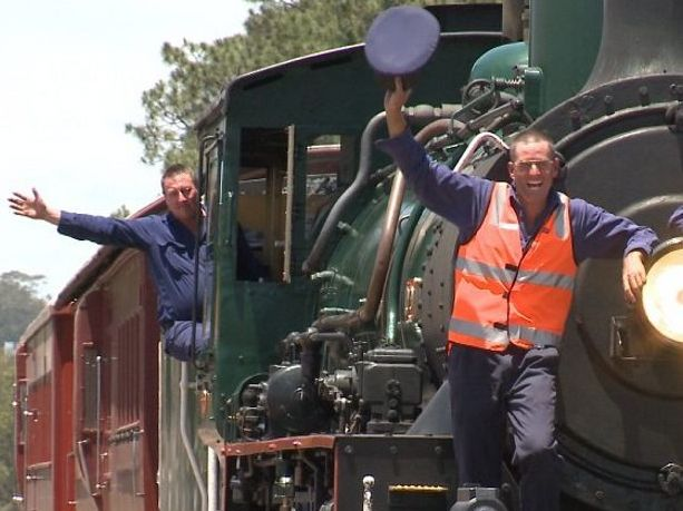 Queensland Rail drivers John Broderick, Paul Ryan, Chris Halliday aboard the 1079 steam engine.