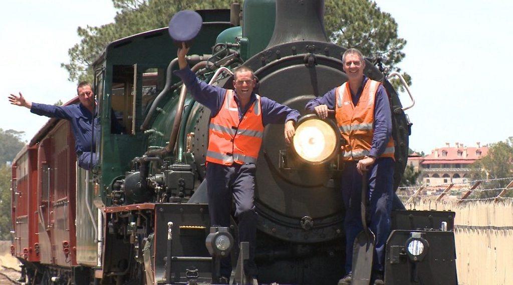 Queensland Rail drivers John Broderick, Paul Ryan, Chris Halliday aboard the 1079 steam engine.