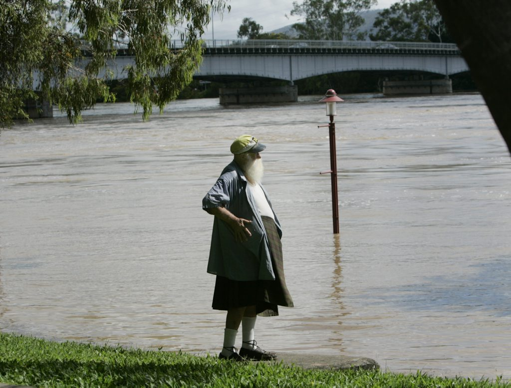 John Guest checks out the view of the flooded Fitzroy River Photo Sharyn O'Neill / The Morning Bulletin ROK151210fit-S4