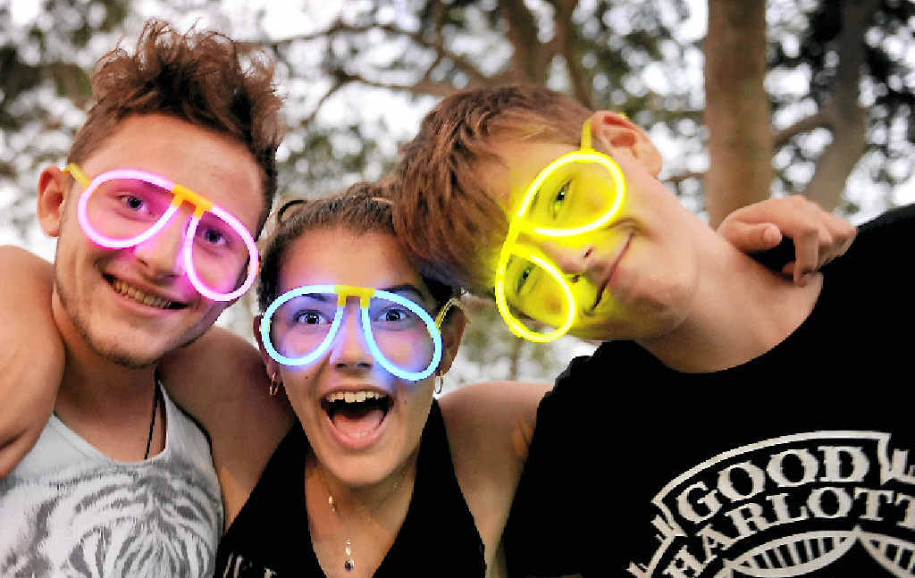 CELEBRATE: Michael Wilkie, Ebony and Coen Andrew enjoy last year's New Year's Eve celebrations at Torquay beach.
