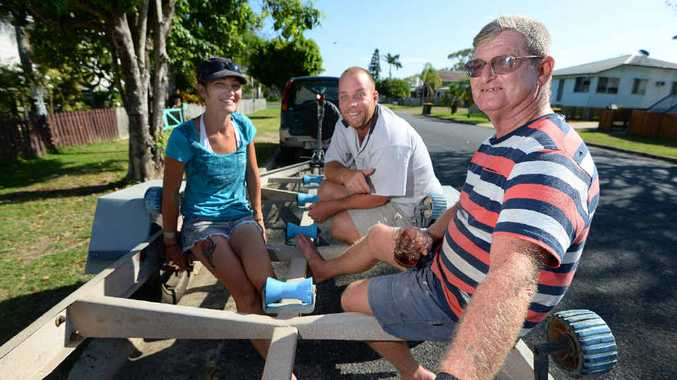 """ON DRY LAND: Grateful to be alive Trevor Walters (right) with Sam Burns and Jonathan """"Marksy"""" Mark who were saved by passing jet skiers after their boat sank. Trevor now has a boat trailer for sale."""