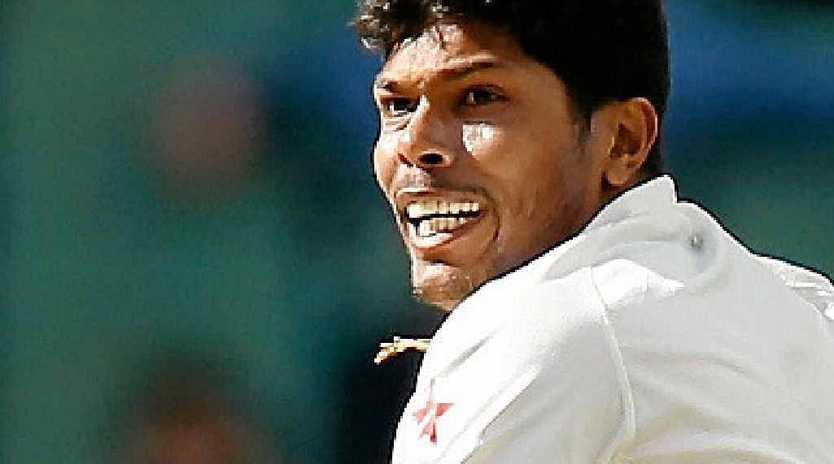 Umesh Yadav, of India, celebrates taking the wicket of Brad Haddin yesterday at the MCG.