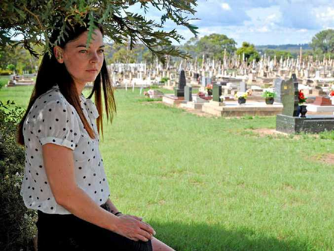 NO COMMUNICATION: Mother Tahni Farrell wants to know why she wasn't notified of a clean-up being done around her children's graves (inset, left) that resulted in the plaques being moved and a granite slab being dug up.
