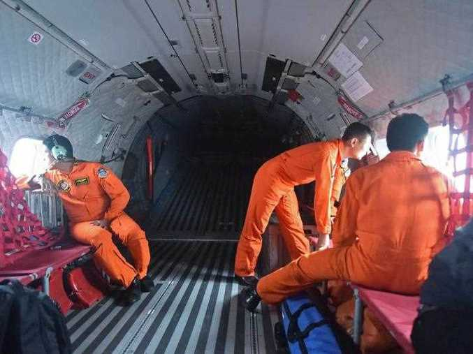 Items resembling an emergency slide, plane door and other objects were spotted in the sea during an aerial search on December 30 for missing AirAsia flight QZ8501, Indonesian officials said.