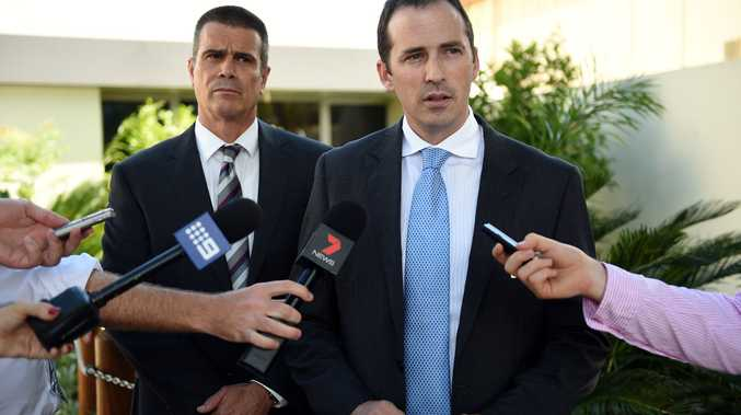 Detective Acting Inspector Ben Fadian Detective Senior Sergeant Tony Green speaks outside the Caboolture police station.
