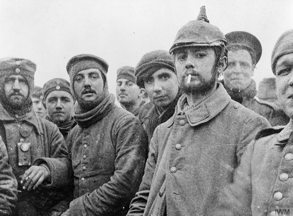 British members of the London Rifle Brigade fraternise with German soldiers of the 104th and 106th Saxon regiments at Ploegsteert, Belgium, on Christmas Day 1914.