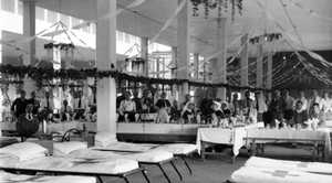 Staff and patients at No 14 Australian General Hospital, Egypt, decorated for Christmas in 1918. In the background, tables are set for Christmas dinner. Courtesy of Australian War Memorial B00682