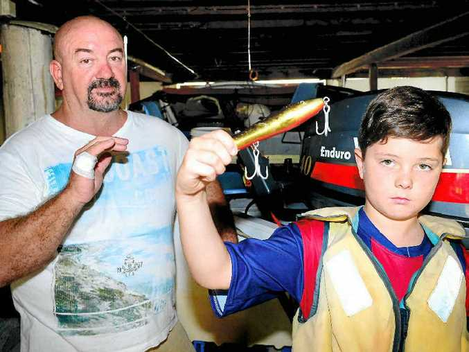 HOOK, LINE AND HAND: Rockhampton's Mark Bates hopes his next fishing trip with his nephew, Lachlan Ewens, will be a lot more enjoyable.