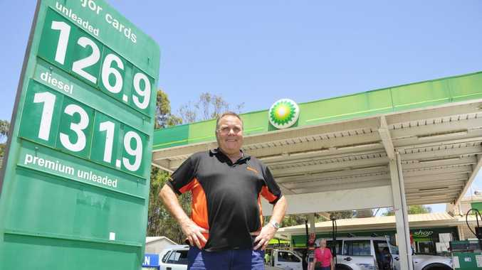 Col Taylor next to what he considers as a reasonable price for fuel. Photo Campbell Gellie / The Observer