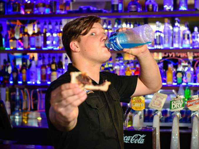Bartender at the Reef Hotel Tom Warrington knows a hangover well and knows how to cure it. Photo Mike Richards / The Observer