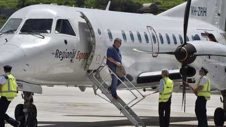 MAKING HISTORY: Guy Oliphant arrives on the first Regional Express Airlines flight from Brisbane to Wellcamp Airport. Photo Bev Lacey / The Chronicle