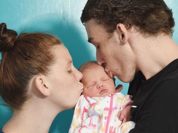 First baby born at Hervey Bay Hospital on January 1 2015- Summer Rose Whitfield with her doting parents Jazmin Wood and Madison Whitfield. Photo: Robyne Cuerel / Fraser Coast Chronicle