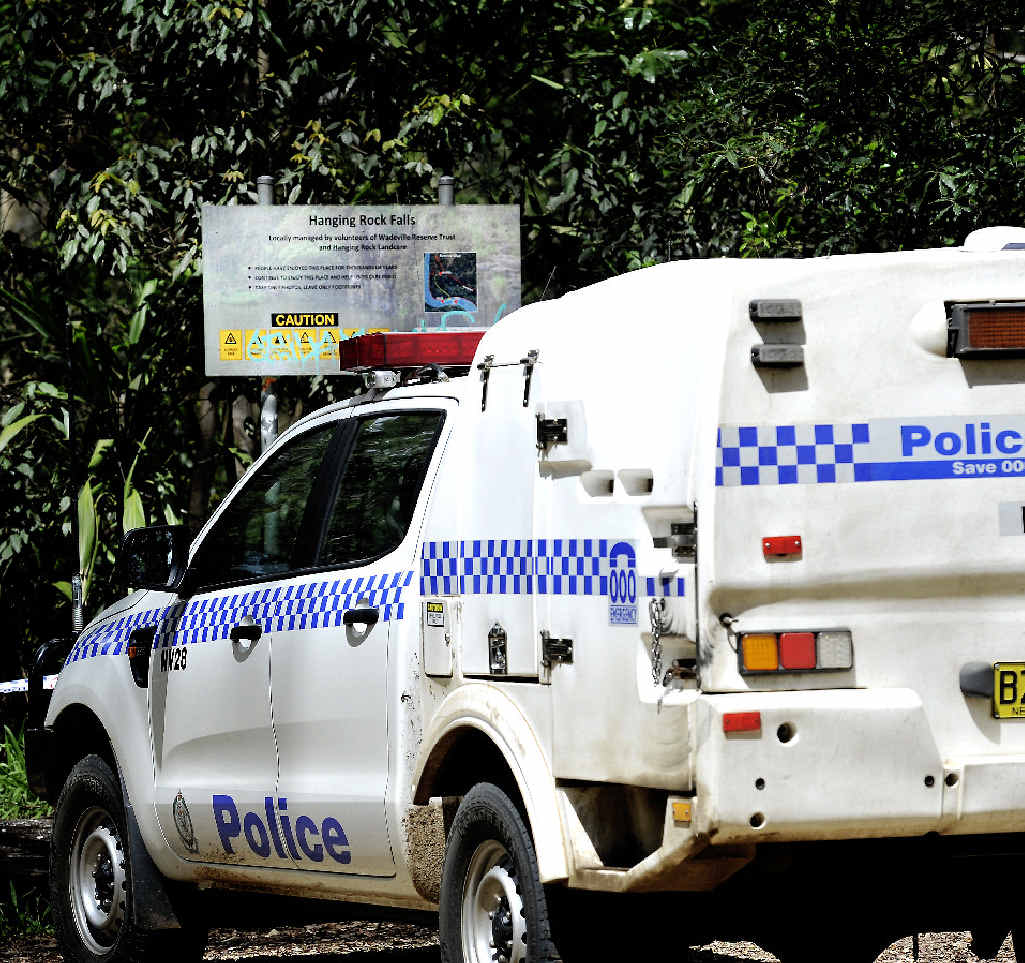 Police at the site at Hanging Rock Falls where a Sydney man went missing.