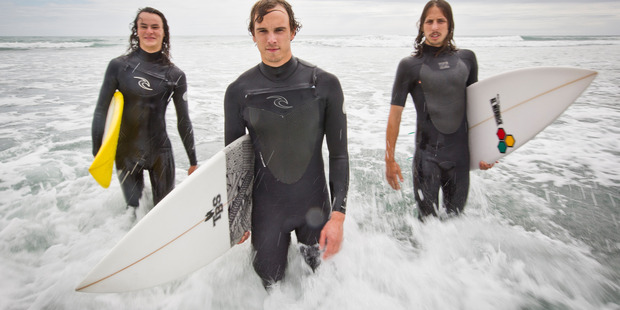 Liam Kennedy, Darren Celliers and Caleb Lemkus. The group helped save a family that got into trouble at Bethells Beach.