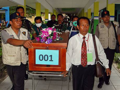 A coffin of a victim of AirAsia flight QZ8501 is transferred from a local hospital in Pangkalan Bun, the town with the nearest airstrip to the crash site of AirAsia flight QZ8501, in Central Kalimantan