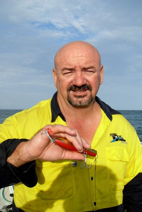 Mark Bates has a fishing lure stuck in his hand from a passing boatie. Photo Contributed