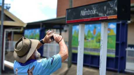 Enthusiasts taking photos at Nambour train station where the Sunlander stopped for the final time after 61 years of service, en route to Brisbane from Cairns. Photo: Iain Curry / Sunshine Coast Daily