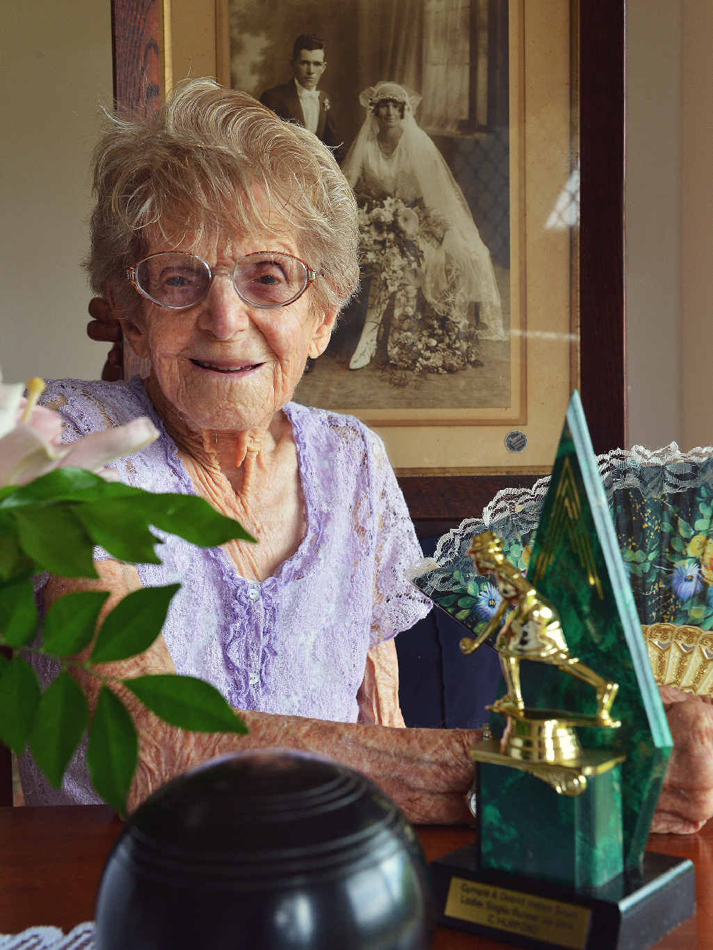 BIRTHDAY GIRL: Charlotte 'Lottie' Hurford celebrated her 105th birthday on December 31, 2014. In the background is a portrait of Lottie's wedding day to husband Phillip on July 22, 1931.