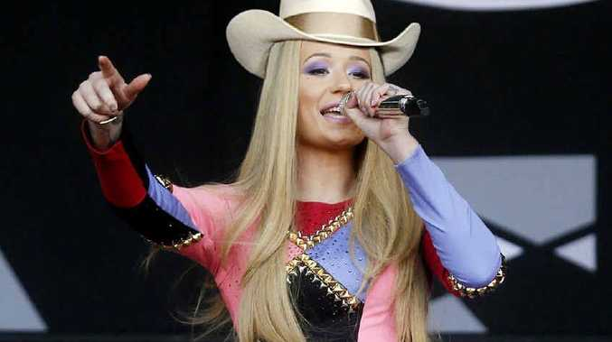 FANCY HAT: Iggy Azalea performs in Austin, Texas. Image Digitally Altered