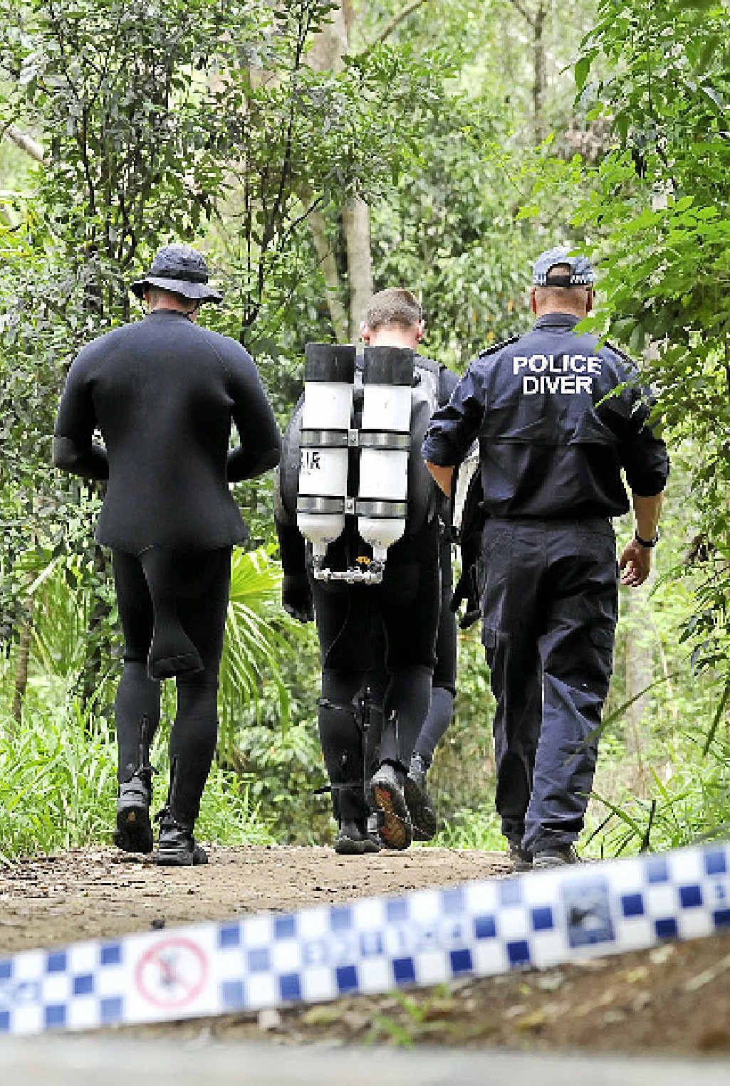 FATAL ATTRACTION: Police at Hanging Rock Falls where a man went missing after he reportedly made contact with the cliff face and vanished below the surface of the water.