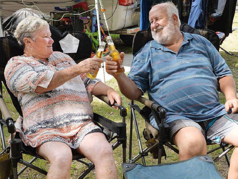 COOL SPOT: Joy and Greg Champney toast the camping life at Blacks Beach.