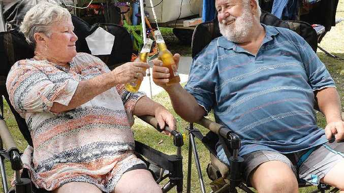 COOL SPOT: Joy and Greg Champney toast the camping life at Blacks Beach.