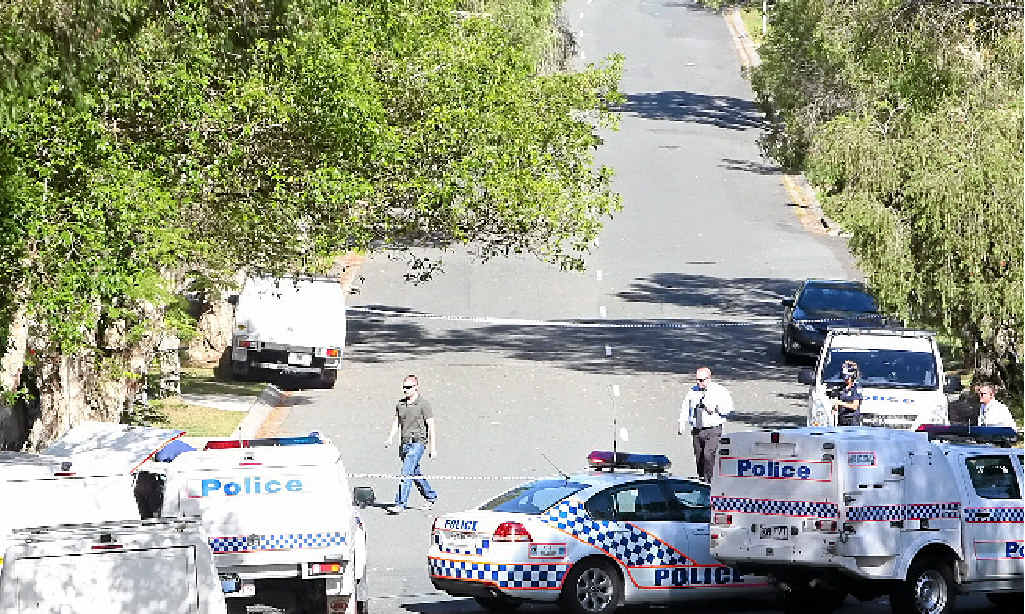 DEATH IN SUBURBIA: Police at the scene of a fatal shooting in Outlook Drive, Tewantin.