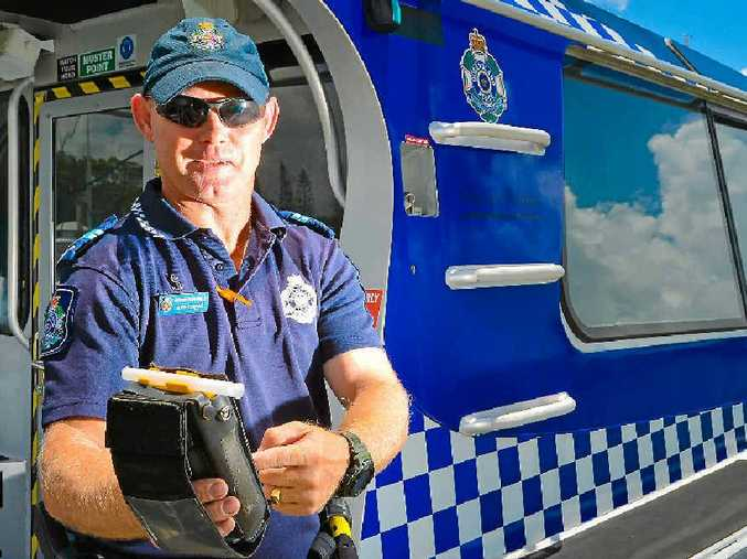 BLOW HERE: Senior Constable John Kernan has been conducting up to 30 random breath tests a day in the Gladstone waterways over the holiday period.