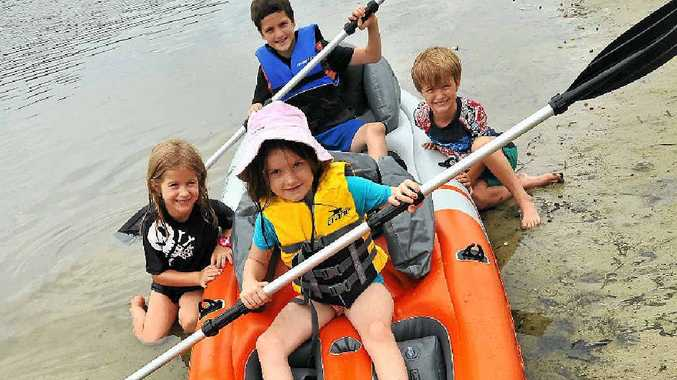 ALL ABOARD: The humidity couldn't stop Kahlia Gillie, 6, with her brother Ashton, 9, in the back seat, along with six-year-old twins Isabella and Elijah Pomroy from having some fun at Stumers Creek, Coolum.