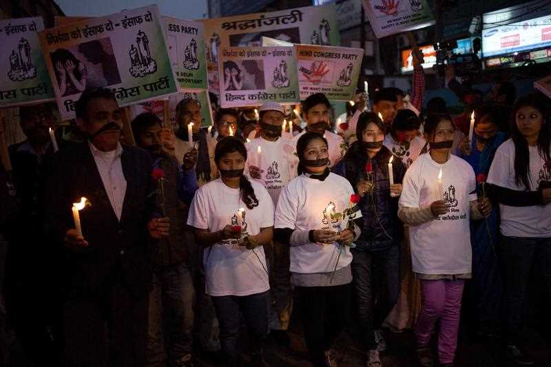 Indian political and civil society activists take part in a vigil to mark the second anniversary of the fatal gang-rape of a student in the Indian capital, at the bus stop in the Munirka area of New Delhi on December 16, 2014.
