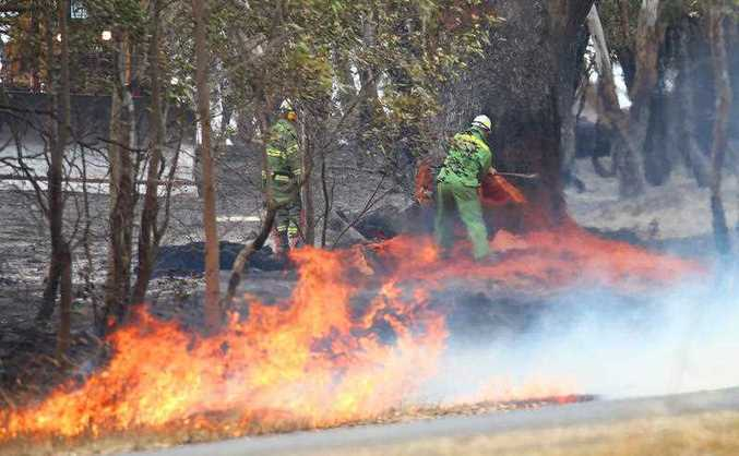 Firefighters work to mop up a fire near Mia Mia in Victoria , Thursday, Dec 18. 2014. Bushfires have been burning in north Eastern Victoria which are believed to have started from lightning strikes.