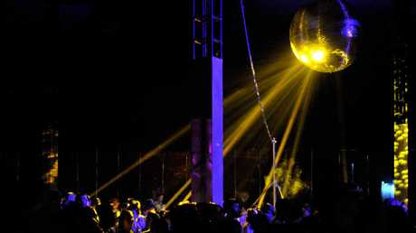 A disco ball shines on audiences at the Falls Festival Byron Bay on Tuesday.