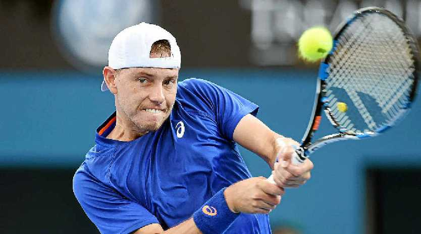 WINNER: Australia's James Duckworth plays a shot during his first round win over Gilles Simon.
