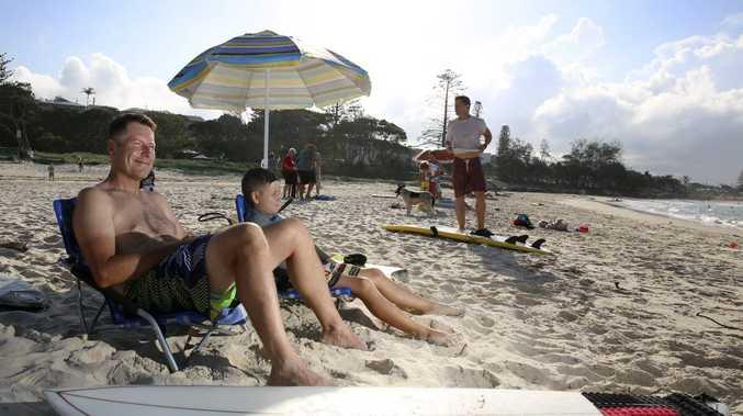 Karl and Eddie Butterfield of Brisbane soaking up the sunshine on Kingscliff beach. Photo: Nolan Verheij-Full / Tweed Daily News
