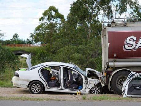 Police inspect a vehicle that crashed into the back of a truck on Redbank Plains Road at Blackstone after evading police in the early hours of Wednesday morning. Photo: Rob Williams / The Queensland Times