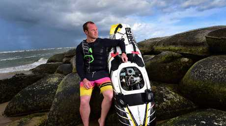 HEAD-TURNER: Cameron Bell with his $17,000 Jetsurf board at Cotton Tree. It can reach a speed of 60kmh. Below: The board in action.