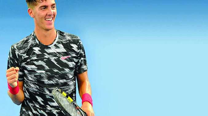 Thanasi Kokkinakis celebrates beating Julien Benneteau in the first round in Brisbane.