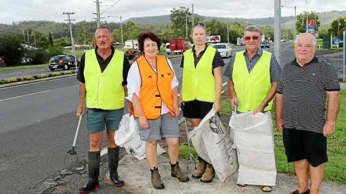 TIDY TOWN: The Withcott Litter Patrol works hard each week to ensure their town does not get the same dirty title as the rest of the state. Pictured are John Bennett, Cr Janice Holstein, Kate Thornton, Eric Canning, and Neil Simpson of the Withcott Hotel.
