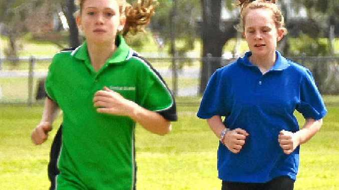 Lauren Smith leads Jazmin Ward during the 800m at Warwick Little Athletics.