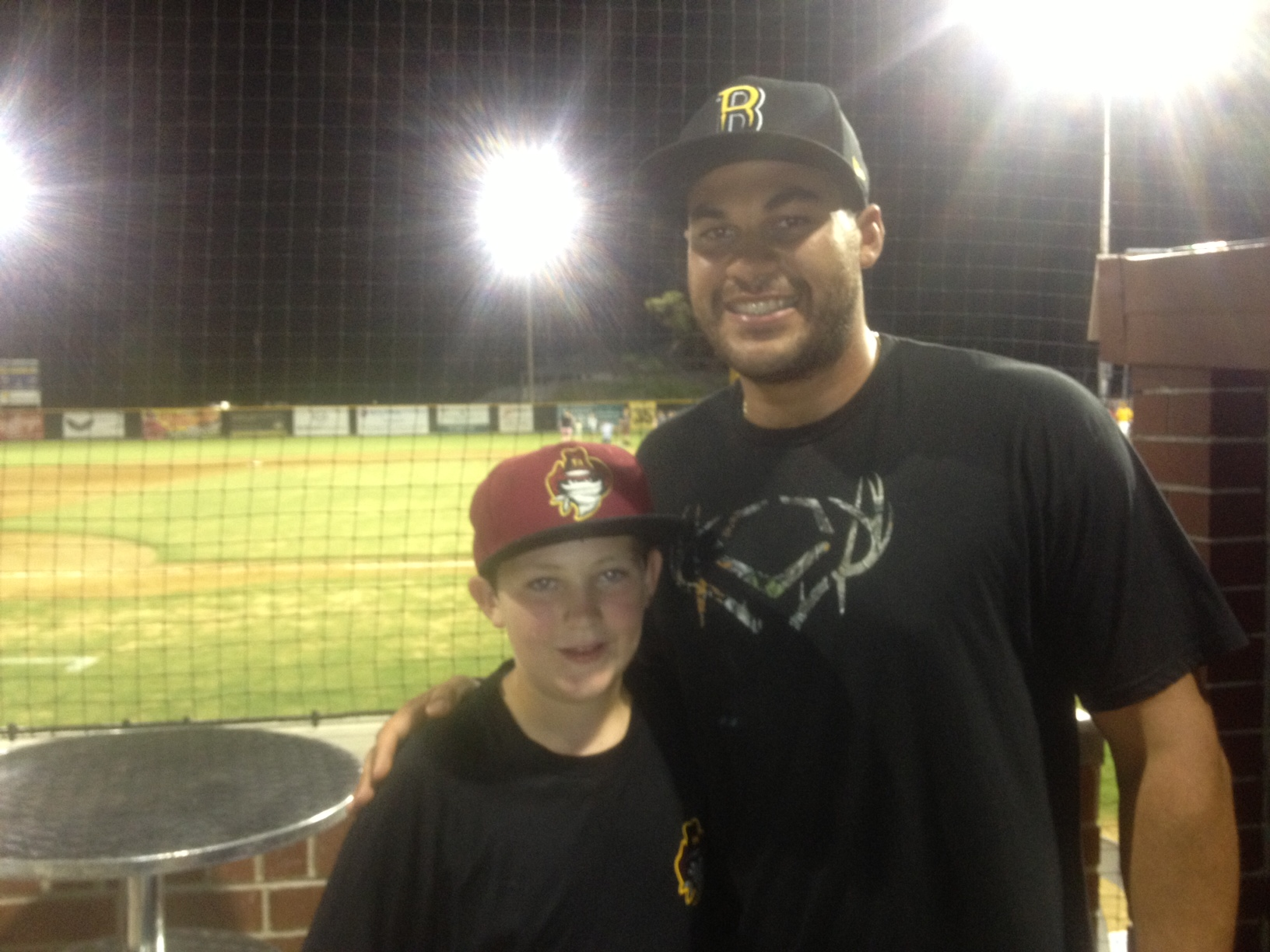 CINCINNATI Reds star Donald Lutz, pictured with young fan Tobey Phillips, says Brisbane's tight-knit baseball community helped get him to the Majors.