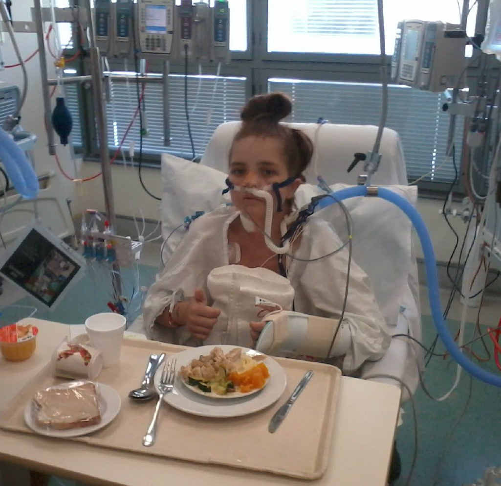 Tracey-Lee Schuhmacher gives two thumbs up following her double lung transplant on Sunday.