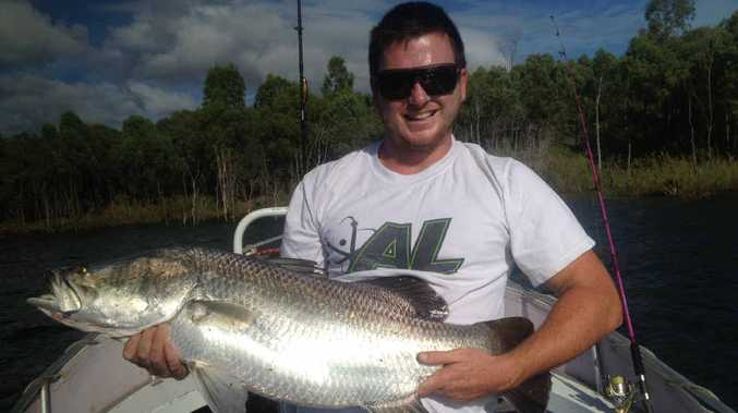 BEAUT BARRA: Jake Causer with the first real barra he has caught and the first to come out of Awoonga Dam in 2015.