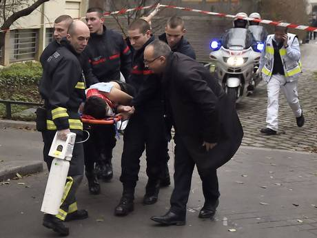A victim is evacuated on a stretcher after armed gunmen stormed the offices of the French satirical newspaper Charlie Hebdo in Paris