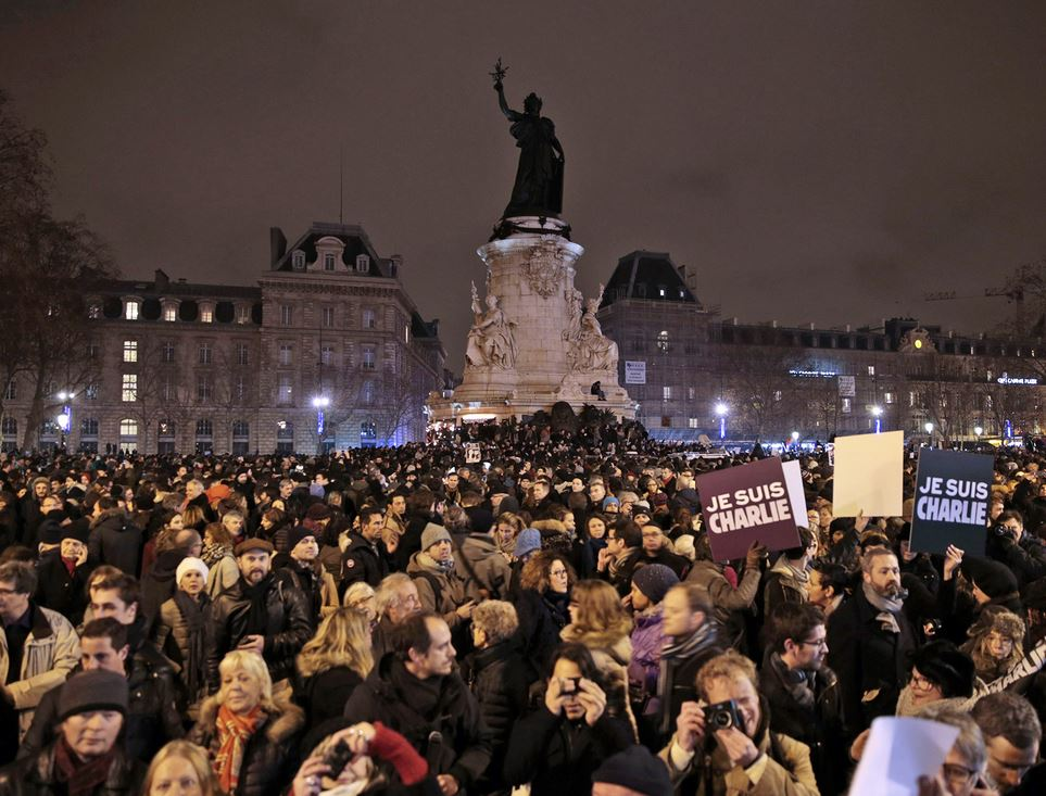 People hold placards reading in French 'I am Charlie' during a gathering at the Place de la Republique in Paris